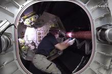 NASA Astronauts Prepare ISS for Commercial Space Taxis