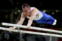 Rio Olympics 2016: Ukraine's Oleg Verniaiev Swings to Bars Gold