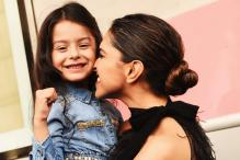 Deepika Padukone Cuddles Up To Child Model Dhyana Madan During a Photoshoot