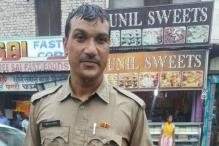 'Barefoot' Haryana Cop Continues Doing His Duty In Heavy Rain, Inspires Many