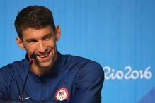 Stars Collide as Phelps Meets Djokovic in Athletes Village