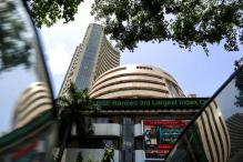 Sensex makes a new record, Nifty tops 9,500 post Fed minutes