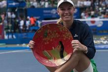 Caroline Wozniacki Downs Naomi Osaka to Win Pan Pacific Open