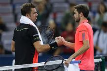 Simon Knocks Out Wawrinka in Shanghai, Djokovic and Murray Advance