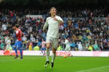 Cristiano Ronaldo Nets Twice as Real Madrid Beat Sporting Gijon 2-1