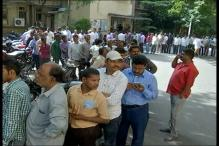 Pay Day: People Queue Up Outside Banks, ATMs