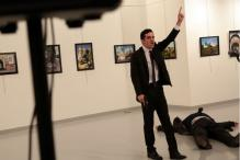 Photographer Who Witnessed Russian Envoy's Killing Recounts The Attack