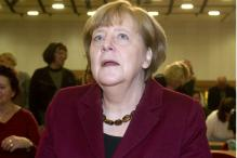 Merkel Says No Solution Yet to Sharing Migrant Burden in EU