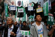 Thousands March to Protest Bid to Unseat Hong Kong Lawmakers