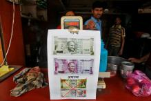 Rupee to Fall to Record Low Over Coming Year: Reuters Poll