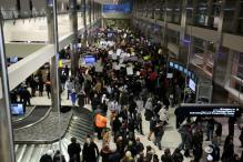 Trump Blames Airport Chaos on Computer Glitches, Protestors