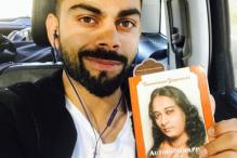 Virat Kohli Promotes Autobiography Of A Yogi on Social Media