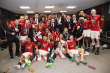 Benched Wayne Rooney Happy to Celebrate League Cup Glory