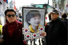 S Korean Court Throws President Out of Office, Two Die in Protest