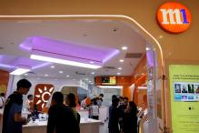 Singapore Telco M1 Rises; Top Shareholders Look to Sell Stakes