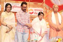 Aamir At Award Show After 16 Years; Receives Honour From Bhagwat