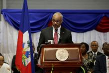 Haiti PM's Motorcade Hits 2, Killing 1, Near Flooded Zone