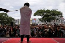 Two Men Caned in Public In Indonesia For Having Gay Sex