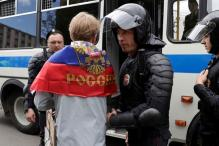 Russian Police Detain Putin Critic Navalny, Scores of Protesters Held