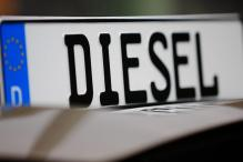 Back From Holiday, Angela Merkel Shifts Gear on Diesel
