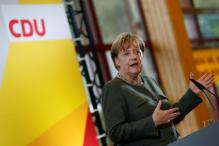 Angela Merkel Warns of Consequences for EU Asylum Laggards