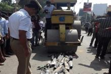Royal Enfield Exhausts Crushed By Bengaluru Traffic Police Using Road Roller