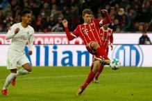 Robert Lewandowski and Thomas Mueller Star as Bayern go 16 Points Clear