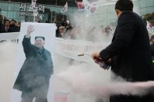 Protesters Greet North Korean Olympic Delegation Touring Seoul
