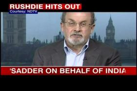 I'll keep coming to India, deal with it: Rushdie