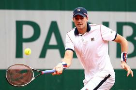 Top Seeds John Isner, Samantha Stosur Fall in Washington Quarters