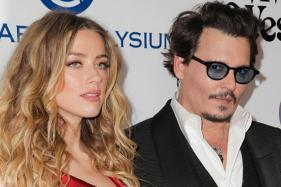Amber Heard, Johnny Depp Fight Over Divorce Donations