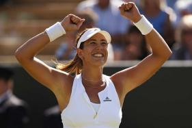Muguruza Eases Past Rogers to Move Into French Open Semis