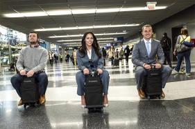 A Lazy Traveler's Dream: A Suitcase That Turns Into a Scooter
