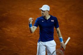 Edmund Puts Britain Ahead Over Serbia in Rain-Hit Davis Cup