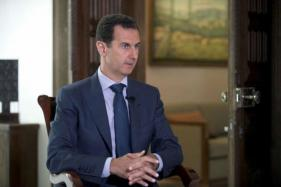 Britain Urges Putin to End Support For 'Toxic' Bashar al-Assad