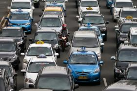 China to Ban Petrol and Diesel Cars To Curb Pollution and Restrict Traffic Congestion
