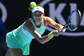 Australian Open 2017: Injury-Hit Muguruza Battles Into Second Round