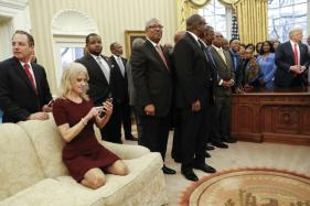Trump Aide Kneels on White House Sofa With Shoes on, Angers Twitterati