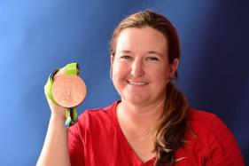 Kimberly's Invisible 'Rhode' to Six Olympic Medals