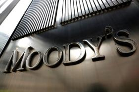Moody's Downgrade of China's Credit Score Hits Yuan