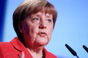 Angela Merkel, Xi Defend Free Trade Ahead of G20 Meet