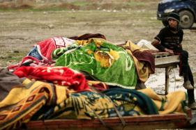Fleeing IS, Mosul's Civilians Cart Out the Living And The Dead