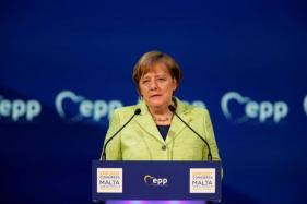 Angela Merkel Optimistic About Electric Car Future, to Invest More