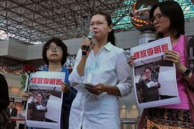 Wife of Taiwan Activist Sees China 'Conspiracy' Behind Husband's Arrest