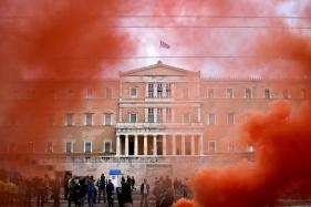 Greece to Approve New Cuts to Secure Cash, Debt Relief