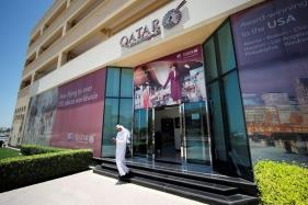 S&P cuts Qatar's credit rating one notch to AA-