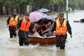 China Floods: 34 Killed in , 93 Missing in Landslide