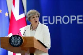 What is British PM May's Working Majority? Answer: 13 votes