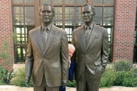 Bill Clinton is Literally Hiding Between Two Bushes in This Viral Photo