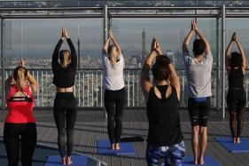 Summer Snapshot: Sky-high Yoga Overlooking The Eiffel Tower in Paris